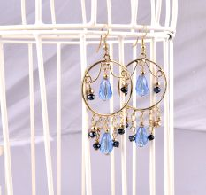 Danglers In Golden Metal Studded With Sky Blue Stones