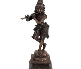 Lord Krishna statue playing a flute