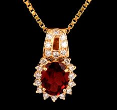 18 K Gold Pendant Single Garnet Stone Decorated With Diamonds